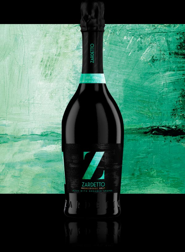 Bottle of Prosecco Brut Organic Grapes photographed in front of it's artwork